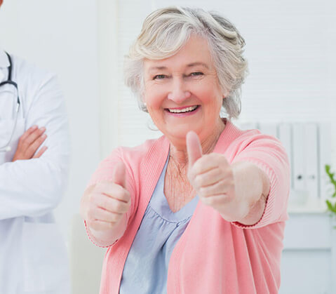 Older woman with thumbs up