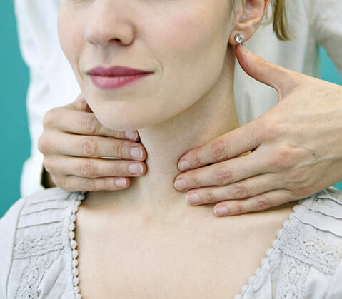Woman having neck examined