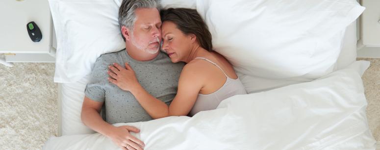 Middle Aged Couple Sleeping