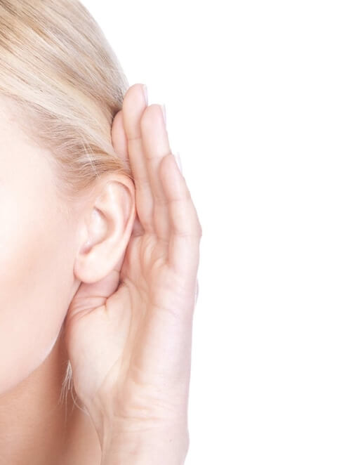woman cupping hand behind ear