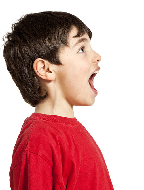 Boy with mouth open profile