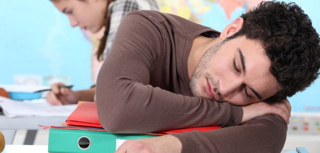 College Student Asleep At Desk