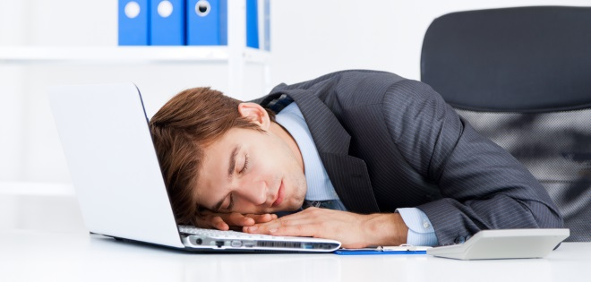 Man in an office suffering from Narcolepsy