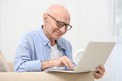 Hearing impaired man using laptop