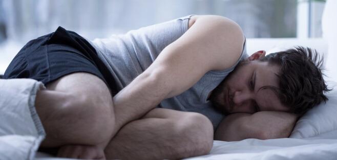 Man sleeping in fetal position