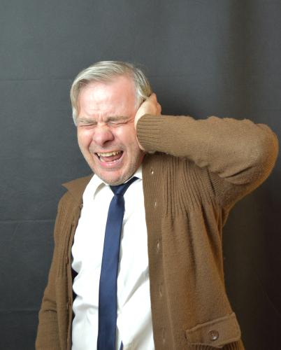 Man suffering from Ear Pain