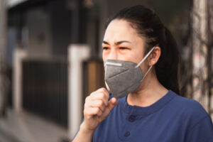 woman wearing covid-19 protective mask