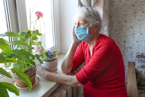 Older woman wearing a mask