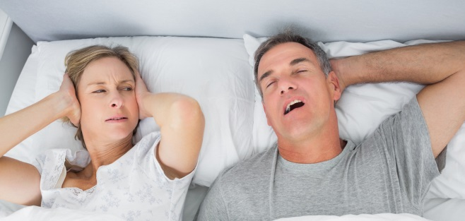 Woman hoping her husband would stop snoring