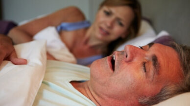 Woman annoyed by partner's snoring