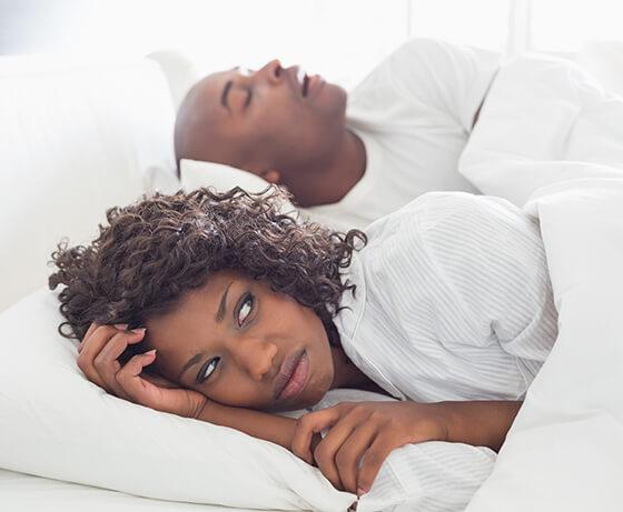 Woman awake because of snoring partner